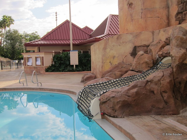 Caribbean Beach Resort, main feature pool slide exit. Note that the slide is netted closed when lifeguards are not on duty.
