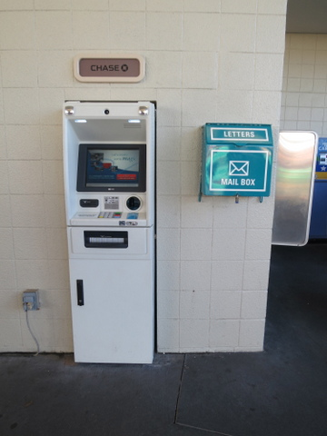 TTC ATM and mailbox, located near the bus zone.
