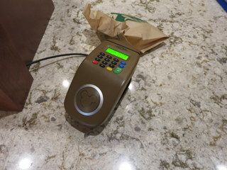 Typical MagicBand Touch-to-Pay pad. This one is at the new Magic Kingdom Starbucks
