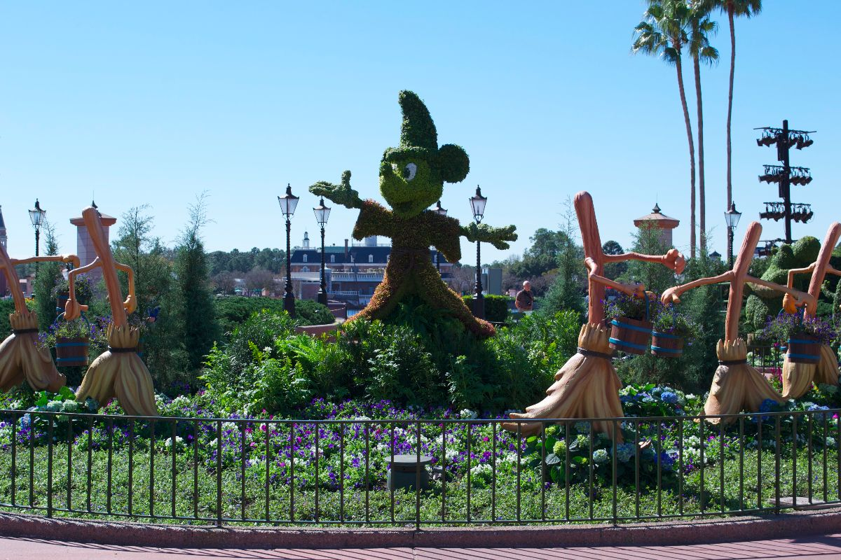 The Mickey, Minnie, and Pluto topiary in the courtyard in front of the tip board.