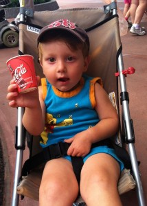 toddler at epcot enjoying epcot's club cool drink offerings