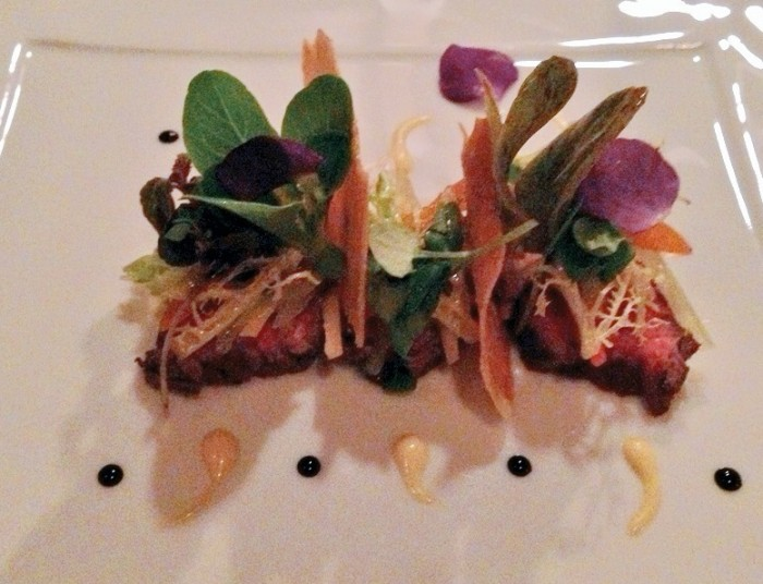 The Colorado bison with black radish slaw and kumquat was a fine example of the quality and presentation of food at Victoria and Albert's. (Photo by Julia Mascardo)
